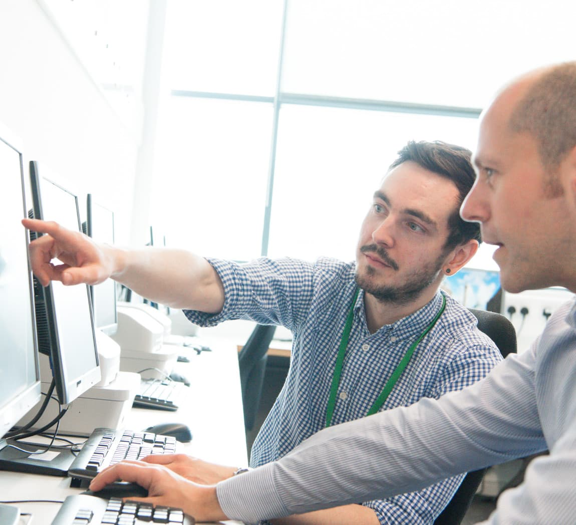 Two men working at a computer